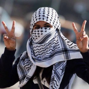 "A Palestinian woman making the victory sign. Photo: from the Facebook page, ""Palestine Belongs to Palestinians!"""